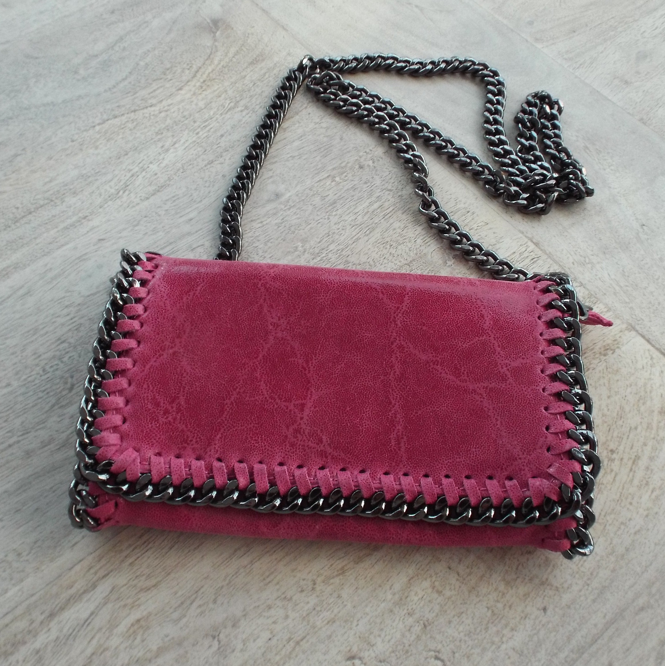 pink leather clutch bag
