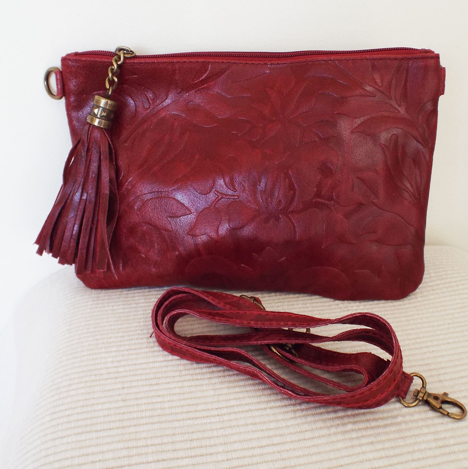 red leather clutch bag