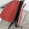 dark green and red satchel (inner)