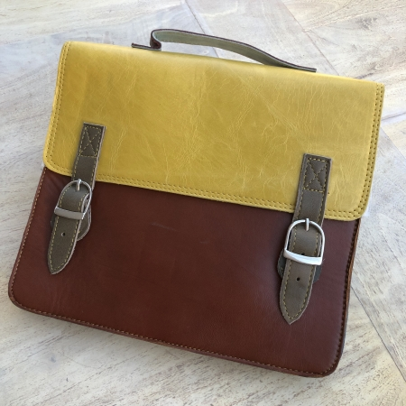mustard and brown leather satchel bag