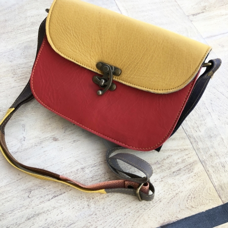 mustard and red small leather satchel bag