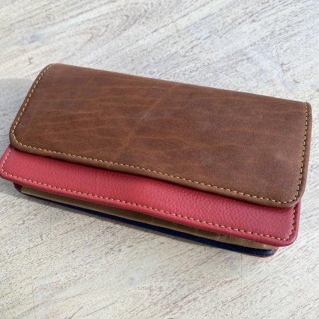 red and tan leather purse