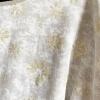 Beige gold design top (detail)
