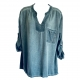 Blue shirt with sequinned fabric neckband and pocket