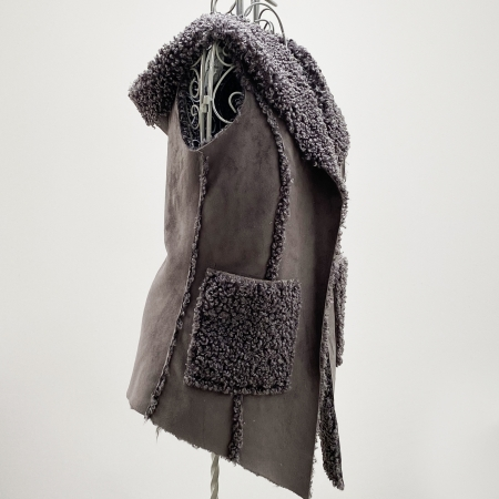 Grey faux sheepskin hooded waistcoat (side)